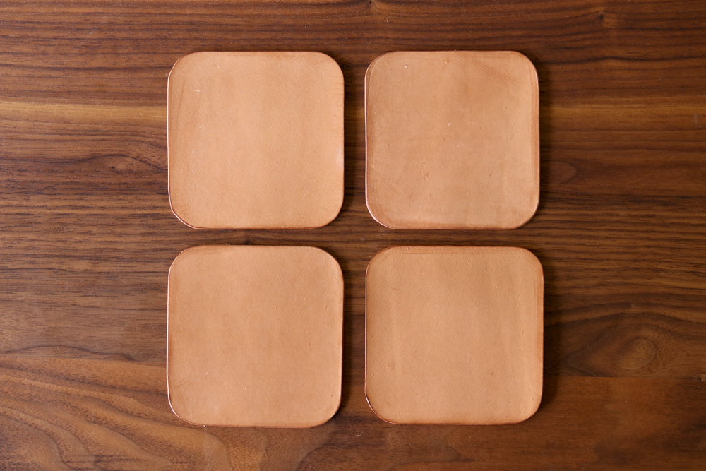 Coming up with the perfect Father's Day gift is really a simple formula: it should be equal parts functional, classic, and stylish, with a dash of long-lasting and a bit of handcrafted. We think these simple leather coasters fit the bill perfectly, but here's the catch: instead of handing your dad or partner a pile of coasters and a bottle of wine, you're going to gift them all the tools and materials to make the coasters themselves. So gather up some tools, materials, and a couple of glasses, and let's celebrate a Father's Day worthy of the Goode Life.